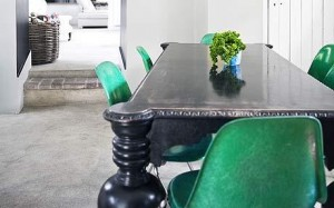 The dining room with its Astier de Villatte table and green Herman Miller chairs