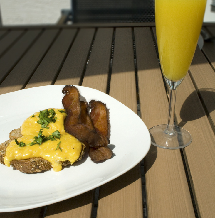 scrambled eggs and bacon with mimosa