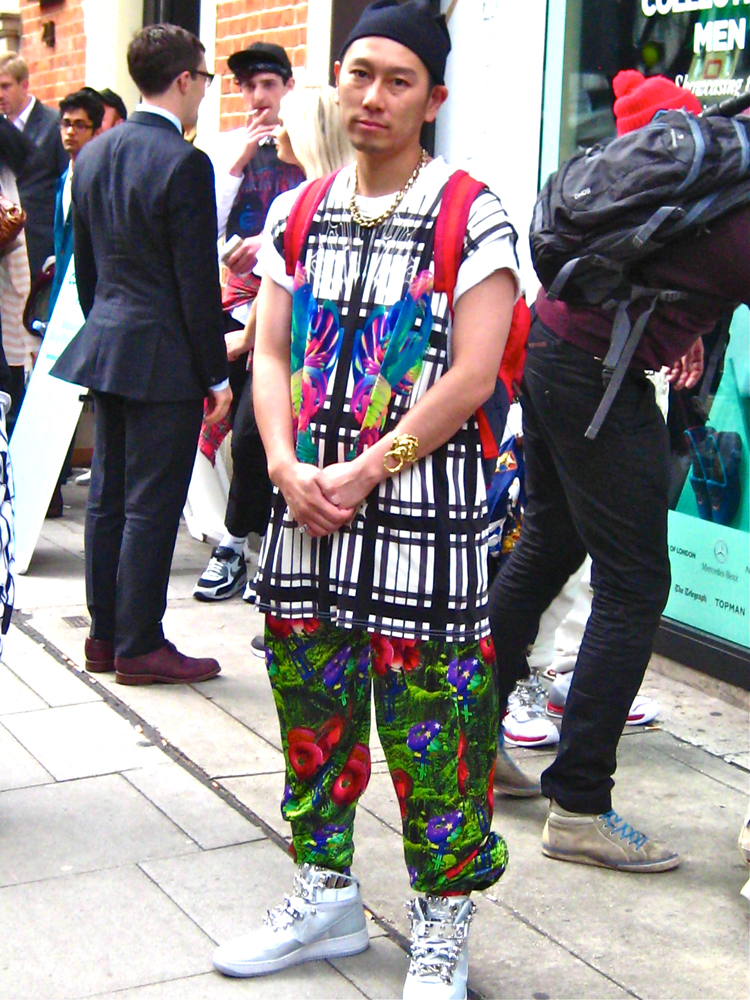 Kubo wearing a top by Alex Mattison with trousers by Casette Playa and Customised Nike from a Tokyo designer