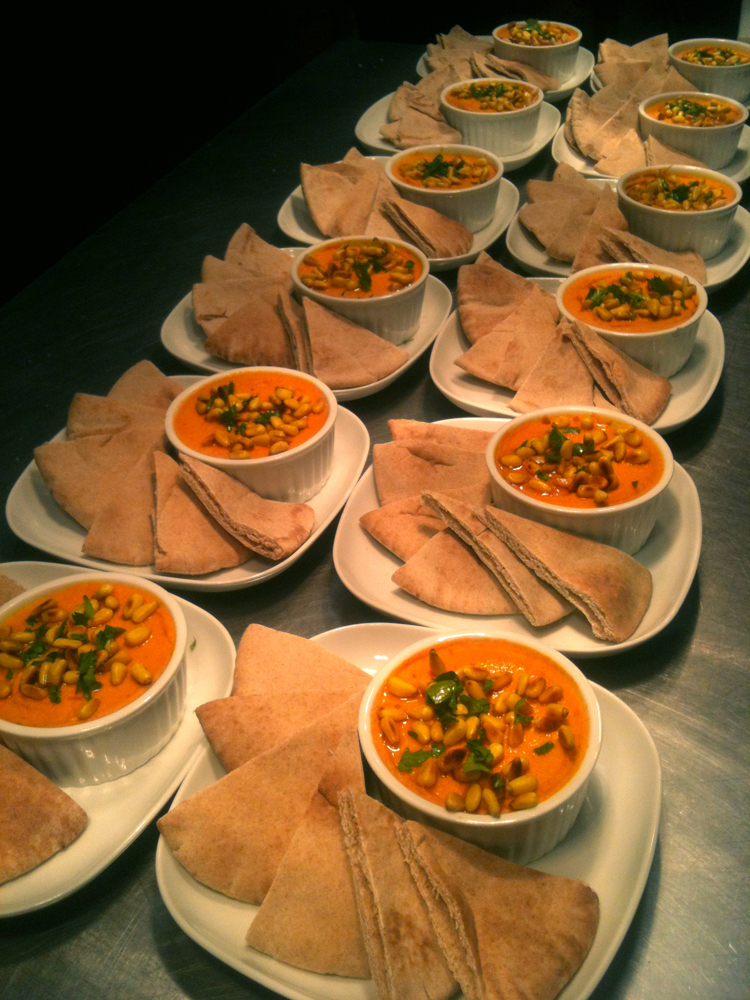 roasted red pepper hummus topped with pine nuts and extra virgin olive oil at interactive monday